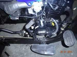 25. Установить педаль заднего тормоза